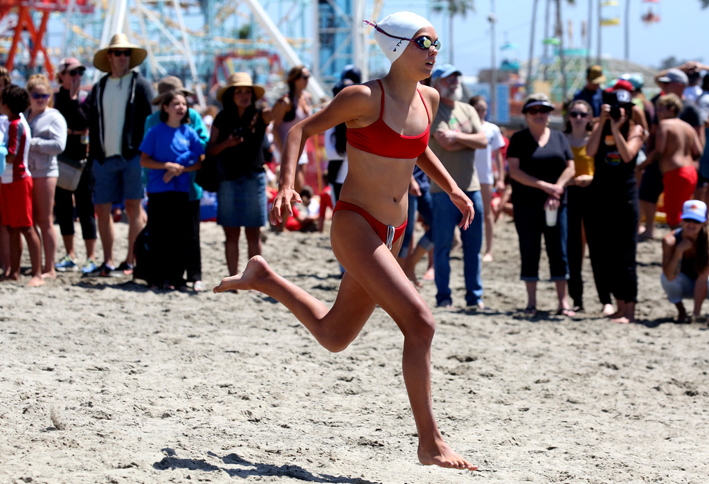 . Junior Guards competition at Main Beach in a regional meet hosted by Seacliff State Beach guards in Santa Cruz on Thursday. Junior Guards from state programs at Manresa, Seacliff, and Twin Lakes participated as well as city junior guards from Santa Cruz, Capitola, Half Moon Bay, and Monterey. The athletes competed in 5 events including run-swim-run, team taplan, paddle relay, land flags and water flags. (Shmuel Thaler -- Santa Cruz Sentinel)   -- Santa Cruz Sentinel)