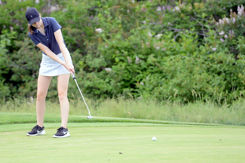 . Brynn Ellis watches the roll of her putt on No. 11 during the Junior Optimist golf tournament Monday at the Olde Course in Loveland. (Mike Brohard/Loveland Reporter-Herald)