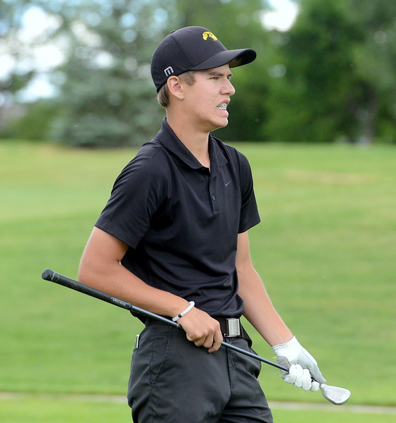 Mason Magley grimmaces as his shot goes a bit offline from its intended target during the Junior Optimist golf tournament Monday at the Olde Course in Loveland. (Mike Brohard/Loveland Reporter-Herald)