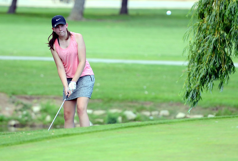 Rylee Collins chips onto the fifth green during the Junior Optimist golf tournament Monday at the Olde Course in Loveland. (Mike Brohard/Loveland Reporter-Herald)