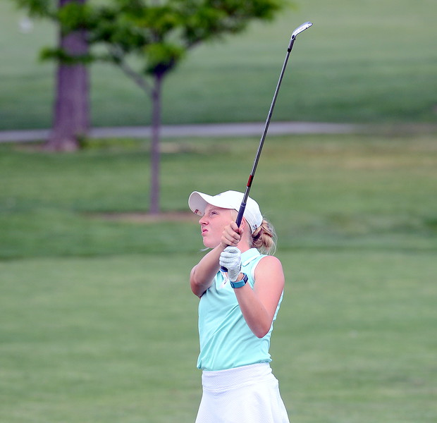Katie Lehigh, who won the girls 13-14 flight with a 41, watches the flight of her approach shot during the Junior Optimist golf tournament Monday at the Olde Course. (Mike Brohard/Loveland Reporter-Herald)