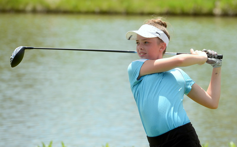 Reece Bandemer watches her drive on No. 6 during the Junior Optimist golf tournament Monday at the Olde Course in Loveland. She won the girls 11-12 and earned a trip to the district tournament with a nine-hole total of 46. (Mike Brohard/Loveland Reporter-Herald)
