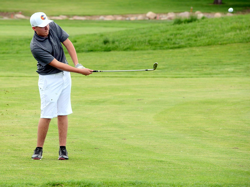 Austin Percha chips on to the green during the Junior Optimist golf tournament Monday at the Olde Course in Loveland. (Mike Brohard/Loveland Reporter-Herald)