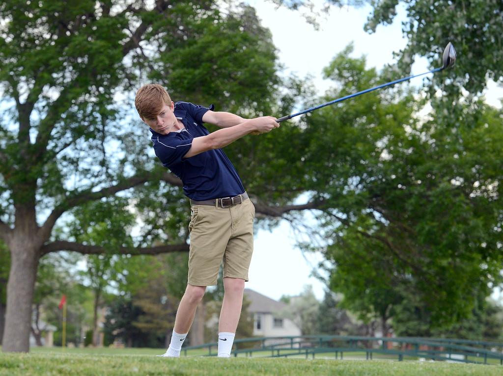. Elliott Gitt unleashes his drive during the Junior Optimist golf tournament Monday at the Olde Course in Loveland. (Mike Brohard/Loveland Reporter-Herald)