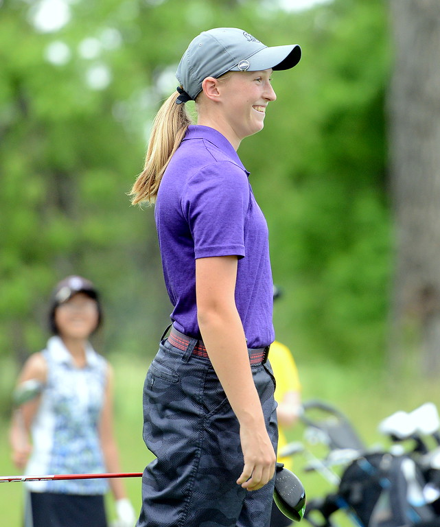 . Gabi Werst smiles as her playing partners applaud an impressive drive on No. 12 during the Junior Optimist golf tournament Monday at the Olde Course in Loveland. (Mike Brohard/Loveland Reporter-Herald)