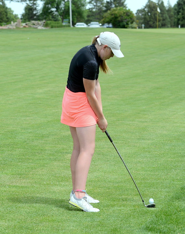 . Taylor Bandemer goes for the ninth green during the Junior Optimist golf tournament Monday at the Olde Course in Loveland. (Mike Brohard/Loveland Reporter-Herald)