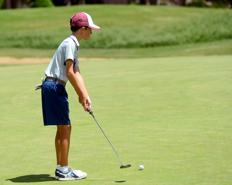 . Austin Barry takes a few practice swings as he reads the green on the third hole during the Junior Optimist golf tournament Monday at the Olde Course in Loveland. (Mike Brohard/Loveland Reporter-Herald)