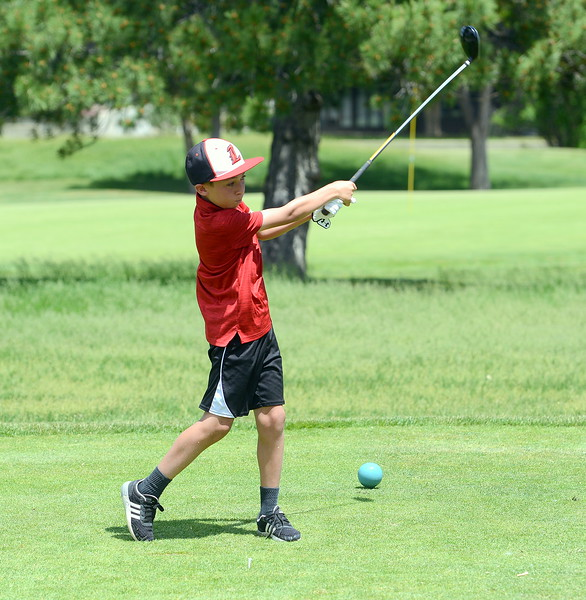 Brady Johnson watches the flight of his drive on No. 4 during the Junior Optimist golf tournament Monday at the Olde Course in Loveland. (Mike Brohard/Loveland Reporter-Herald)