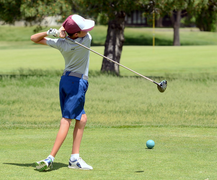 Austin Barry follows through on his drive on the fourth hole during the Junior Optimist golf tournament Monday at the Olde Course in Loveland. Barry won the boys 10-11 age group wihth a nine-hole todal of 37, qualifying him for the district tournament. (Mike Brohard/Loveland Reporter-Herald)