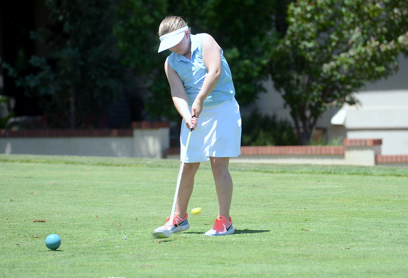 Sophie Morgan drives off the box during the Junior Optimist golf tournament Monday at the Olde Course in Loveland. (Mike Brohard/Loveland Reporter-Herald)