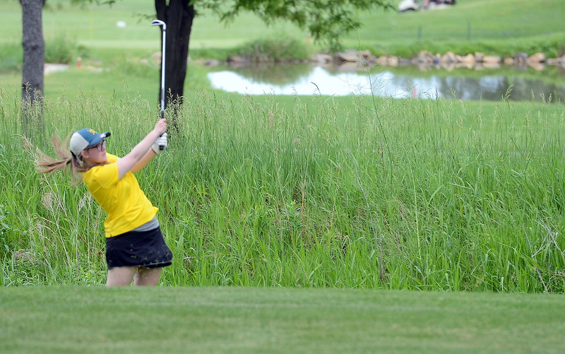 Katie O'Neil hits out of the rough during the Junior Optimist golf tournament Monday at the Olde Course in Loveland. (Mike Brohard/Loveland Reporter-Herald)
