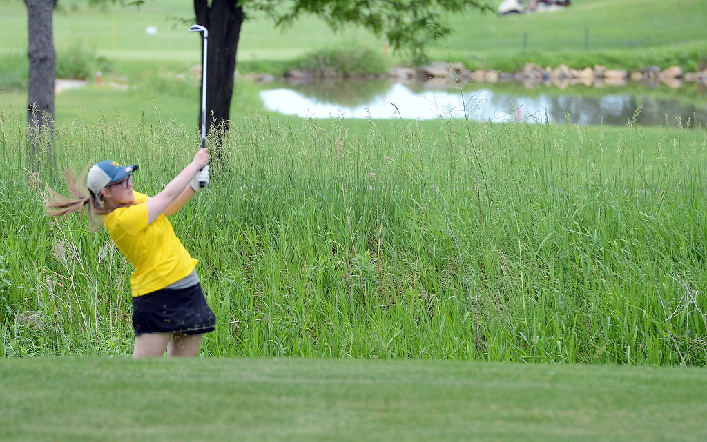 . Katie O\'Neil hits out of the rough during the Junior Optimist golf tournament Monday at the Olde Course in Loveland. (Mike Brohard/Loveland Reporter-Herald)
