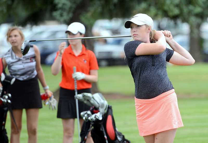 Taylor Bandemer watches her drive off No. 10 during the Junior Optimist golf tournament Monday at the Olde Course in Loveland. (Mike Brohard/Loveland Reporter-Herald)