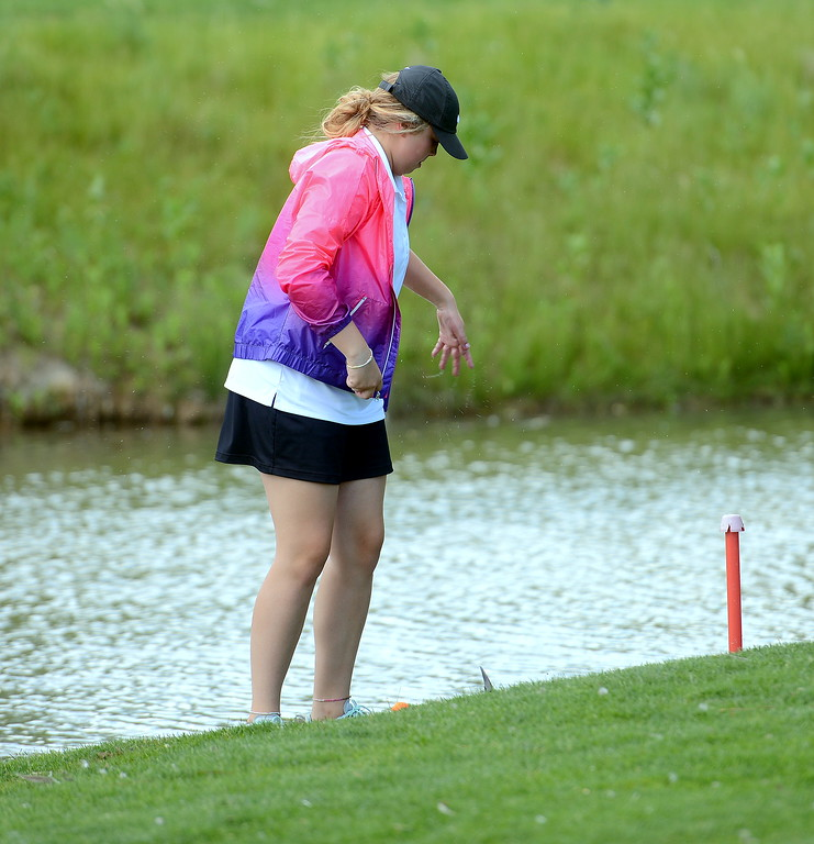 . Caitlin Morgan shakes water from her hand after retreiving her ball during the Junior Optimist golf tournament Monday at the Olde Course in Loveland. (Mike Brohard/Loveland Reporter-Herald)