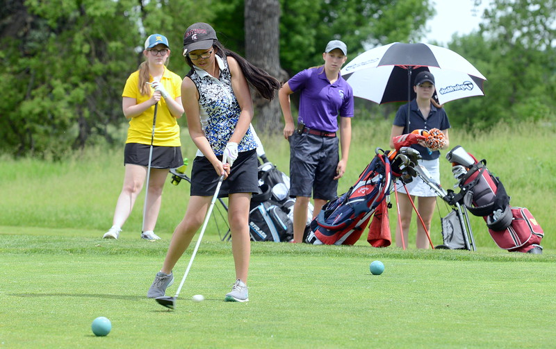 Rayna Nanto hits her driver on No. 12 during the Junior Optimist golf tournament Monday at the Olde Course in Loveland. (Mike Brohard/Loveland Reporter-Herald)