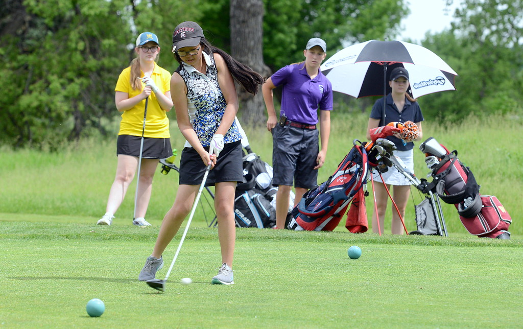 . Rayna Nanto hits her driver on No. 12 during the Junior Optimist golf tournament Monday at the Olde Course in Loveland. (Mike Brohard/Loveland Reporter-Herald)
