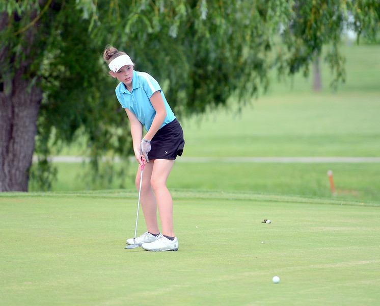 Reece Bandemer watches the path of her putt on No. 5 during the Junior Optimist golf tournament Monday at the Olde Course in Loveland. (Mike Brohard/Loveland Reporter-Herald)