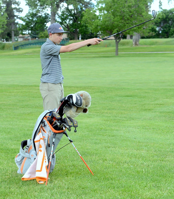 . Dylan Malone lines up his approach shot during the Junior Optimist golf tournament Monday at the Olde Course in Loveland. (Mike Brohard/Loveland Reporter-Herald)