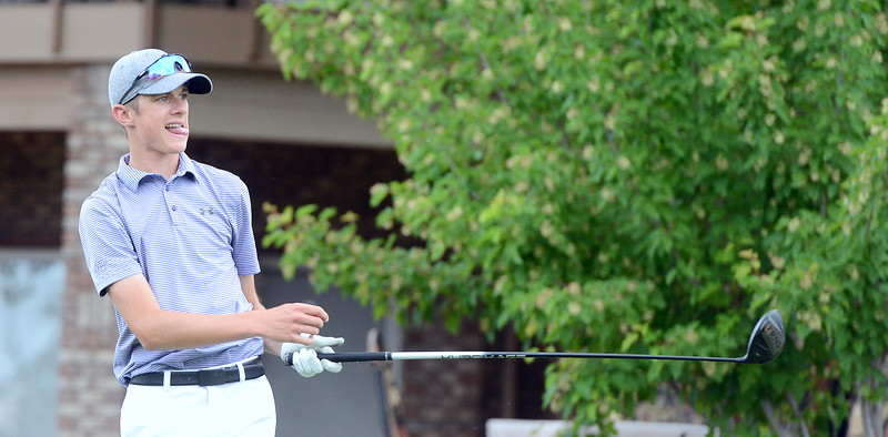 Wes Weber reacts as his drive on No. 17 goes left during the Junior Optimist golf tournament Monday at the Olde Course in Loveland. Weber won the boys 16-18 division on a card playoff after a three-way tie at 79. (Mike Brohard/Loveland Reporter-Herald)