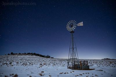 Windmill lit by moonlight