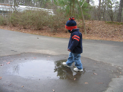little boys and puddles....