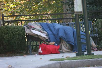 homeless person sleeping on a bench in Atlanta, Georgia