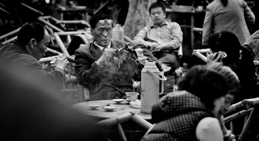 Chinese Teahouse, a man going through Mao's little red book, Chengdu 2013 October