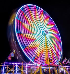 Spinning ferris wheel, Mesa Co. Fair, Grand Junction, Colorado