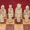 The white pieces. The pawns are simple objects that do not depict people.