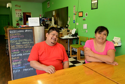 Tania Barricklo-Daily Freeman                      Just for You owners Leonides Santos Agustin, left, and Ines Santos Perez sit in their traditional Oaxacan food  restaurant  on Broadway in Midtown Kingston, across from the HealthAlliance.