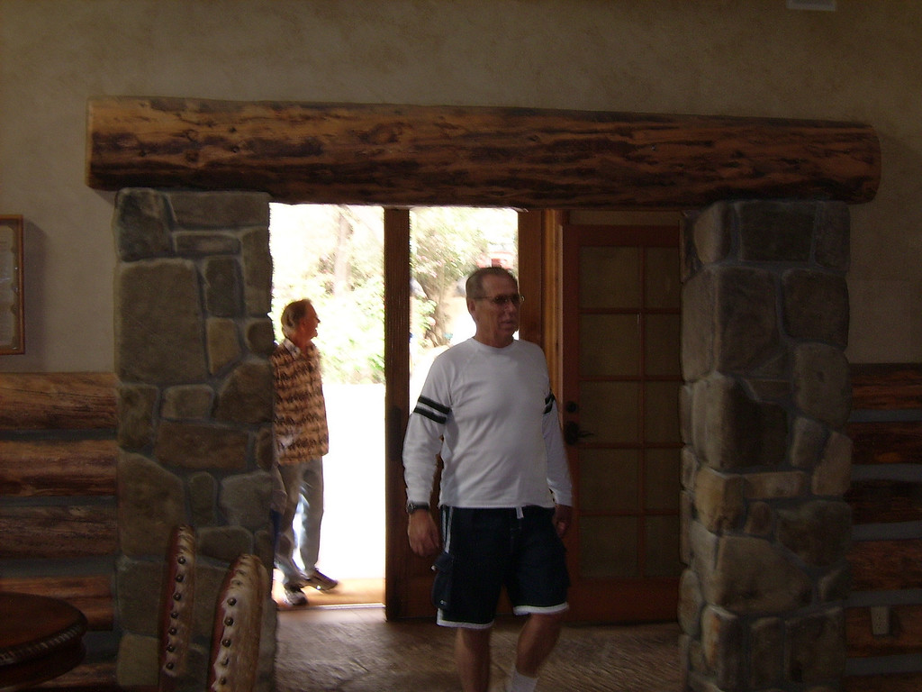 Conejo Ski Club President, Paul Walker arrives, coming into the huge main gathering room in the Guest Ranch.