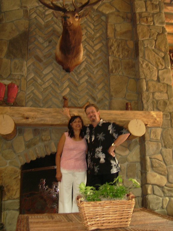 Patricia Bowman and Bob Buckland by the Fireplace in the Guest Ranch.