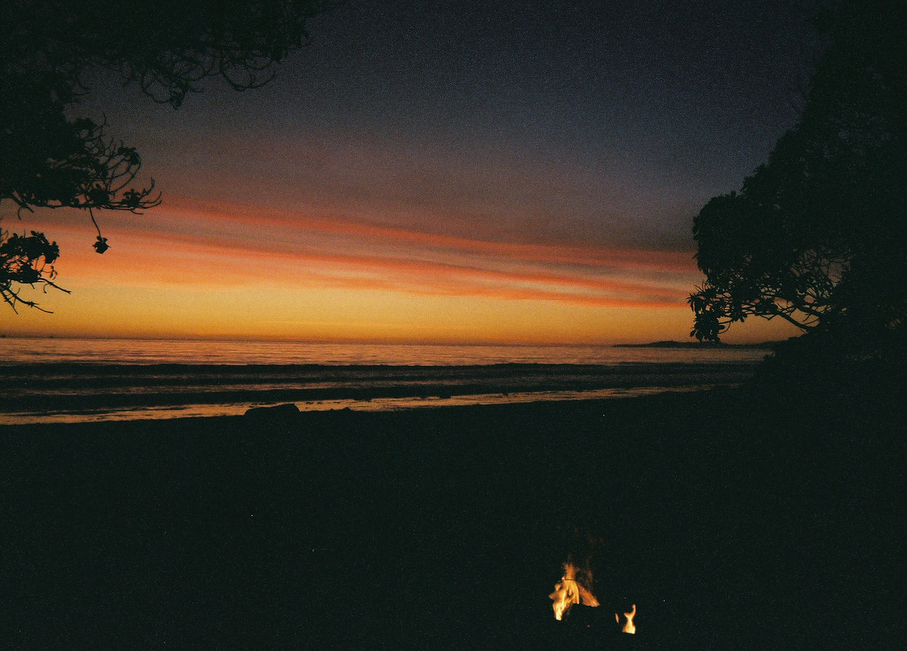As the final rays of the 1st sunset of 2007 paint the waves on the Pacific ocean shore, we build a bonfire for the evening hours.