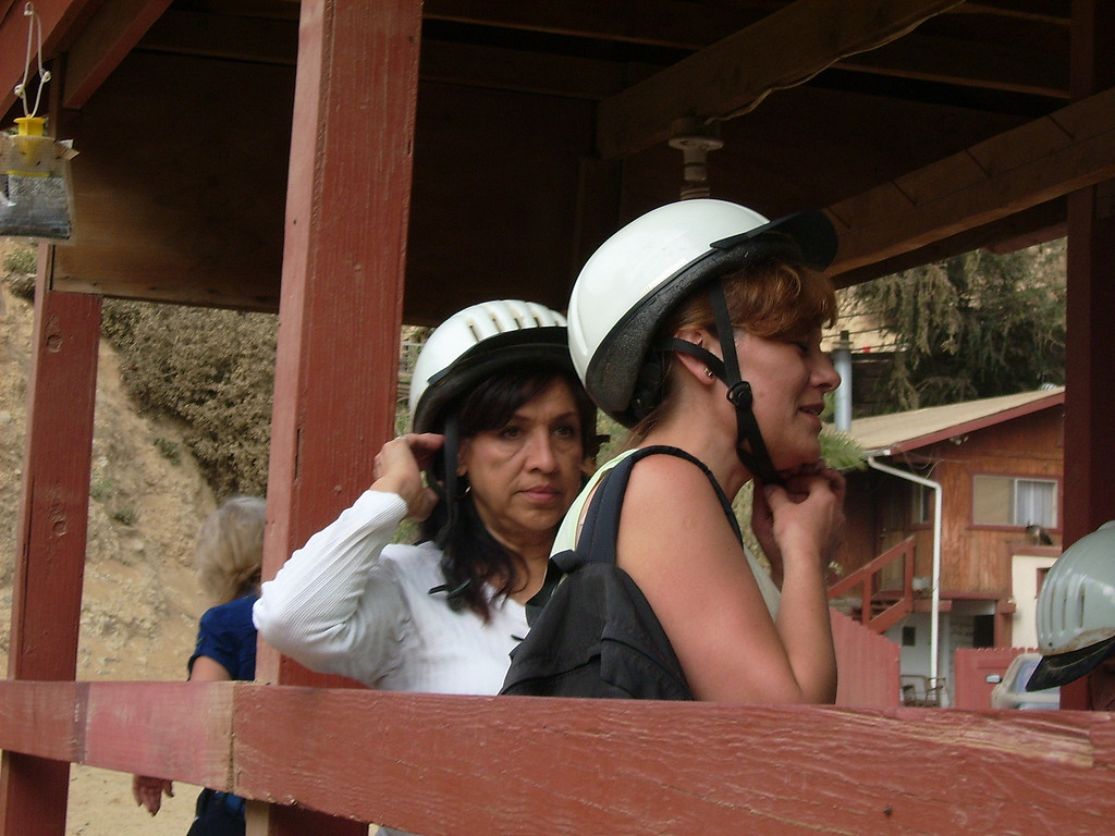 Patricia Bowman and Emilia Balke strap on their helmets for safety as they move to the front of the line.