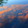 clouds reflecting off window...