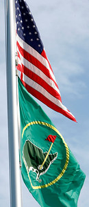 The Augusta National Flag flies below the American Flag in a light morning breeze during the Wednesday Practice Day at the 2010 Masters at Augusta National Golf Club.