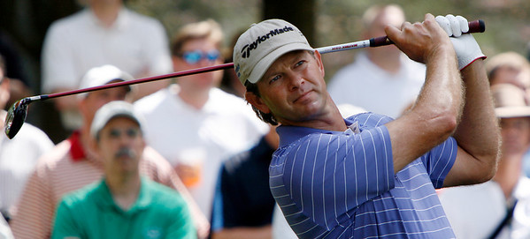 Retief Goosen watches his tee shot fly toward the par-three fourth hole during the Wednesday Practice Day at the 2010 Masters at Augusta National Golf Club.