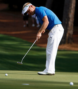 Soren Kjeldsen practices uphill putts on the tenth green during the Wednesday Practice Day at the 2010 Masters at Augusta National Golf Club.