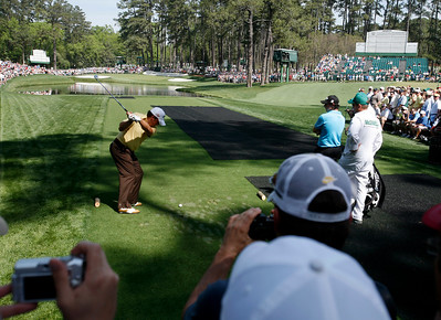 Graeme McDowell hits his tee shot on the 16th hole during the Wednesday Practice Day at the 2010 Masters at Augusta National Golf Club.