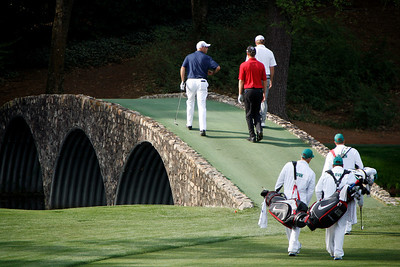 Cink, Senden and Glover cross the Hogan Bridge on their way to the 12th green during the Wednesday Practice Day at the 2010 Masters at Augusta National Golf Club.