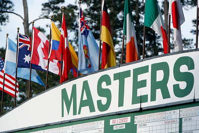 Flags representing players' home countries flutter above the main scoreboard during the Wednesday Practice Day at the 2010 Masters at Augusta National Golf Club.