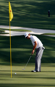 Kevin Na putts up toward the flag on the tenth green during the Wednesday Practice Day at the 2010 Masters at Augusta National Golf Club.
