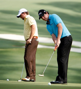 Graeme McDowell, left, and Rory McIlroy practice on the tenth green during the Wednesday Practice Day at the 2010 Masters at Augusta National Golf Club.