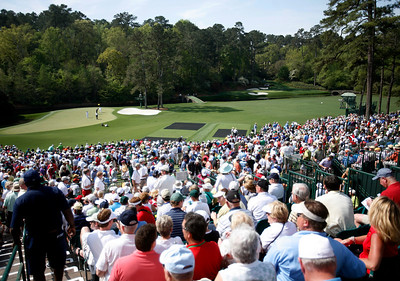 A large gallery watches the action at Amen Corner during the Wednesday Practice Day at the 2010 Masters at Augusta National Golf Club.