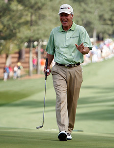 Ben Crenshaw jokes with patrons surrounding the tenth green during the Wednesday Practice Day at the 2010 Masters at Augusta National Golf Club.