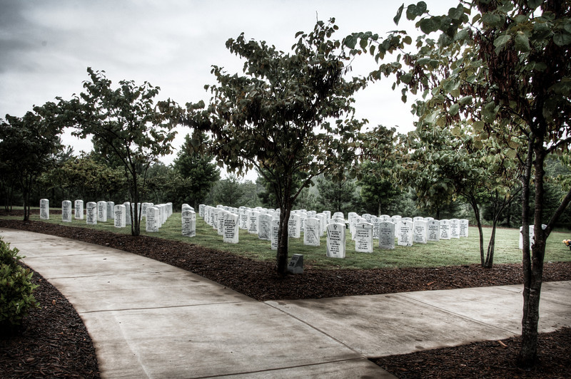 """<h3 style=""""text-align: left;""""><strong>Today's Photo: Diverging Paths</strong></h3> Like the paths around these memorial gardens, the lives of these soldiers took many different paths.  They also came from may different paths, but all shared one thing in common.  A love for a county and a duty to serve.  For what ever reasons, these men and women decided to give a part of them to keep an idea alive.  Although many never knew each other, they share this common bond.  Both in life and now in death."""