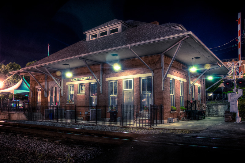 """<h3 style=""""text-align: left;""""><strong>Today's Photo: Cartersville Train Depot</strong></h3> I took a stroll around downtown Cartersville the other night.  For anyone that knows, it was not a long stroll.  However, it was kinda pleasant.  It was not so cold that it was unbearable, but it sure beats the heat we usually have around here.  Too bad this was the weekend that was the calm before the storm.  I mean, three days of constant rain and another one predicted.  At least it made for a few good photo opportunities.  Those photos shall be posted soon.  - Daryl Clark  Read more at the <a href=""""http://justshootingmemories.com"""">Daily Photography Blog</a> Just Shooting Memories!..."""