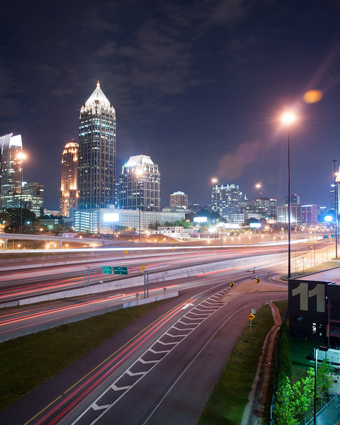"""<h3><strong>Today's Photo:  Station 11</strong></h3> Last weekend, prior to the crash, I went to Midtown Atlanta for some nighttime skyline shots.  My plan was to shoot from the 17th street bridge south.  Unfortunately, that side of the bridge was closed for construction work and I could not get what I wanted.  I did get this shot from the Atlantic Station side of the bridge.  The 11 is on the side of Atlanta Fire Department Station 11.  I'm gonna wait a couple months and hope that the construction is gone and try again.  - Daryl Clark  Read more at the <a href=""""http://justshootingmemories.com"""">Daily Photography Blog</a> Just Shooting Memories!..."""