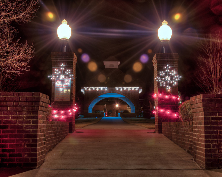 """<h3 style=""""text-align: left;""""><strong>Today's Photo:  Pillar Lights</strong></h3> This is the entrance to the park in downtown Fairmount, Georgia.  Driving by, I had noticed the tree set up in the park and decided to stop.  As I was walking around, I noticed these snowflake lights on the pillars on the back entrance to the park.  I liked the different color lights and the blue glow coming from inside the pavilion in the center of the park.  - Daryl Clark  Read more at the <a href=""""http://justshootingmemories.com"""">Daily Photography Blog</a> Just Shooting Memories!..."""