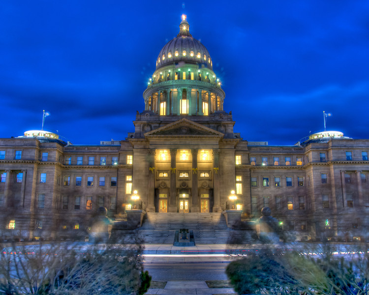 """<h3 style=""""text-align: left;""""><strong>Today's Photo:  Idaho's Liberty Bell</strong></h3> Sitting in front of the Idaho state capitol is a replica of the Liberty Bell.  I stood across the street, in front of the statue of Governor Frank Steunenberg to take this shot.  There is a pathway with several large bushes lining it.  Because the wind was so bad, the bushes just whipped around and made an eerie shadow of the bushes across the front of the capitol.  - Daryl Clark  Read more at the <a href=""""http://justshootingmemories.com"""">Daily Photography Blog</a> Just Shooting Memories!..."""